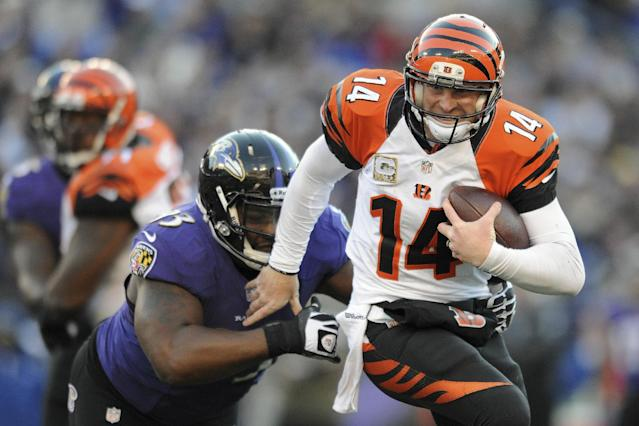 Cincinnati Bengals quarterback Andy Dalton is sacked by Baltimore Ravens defensive end DeAngelo Tyson during the second half of a NFL football game in Baltimore, Sunday, Nov. 10, 2013. (AP Photo/Gail Burton)