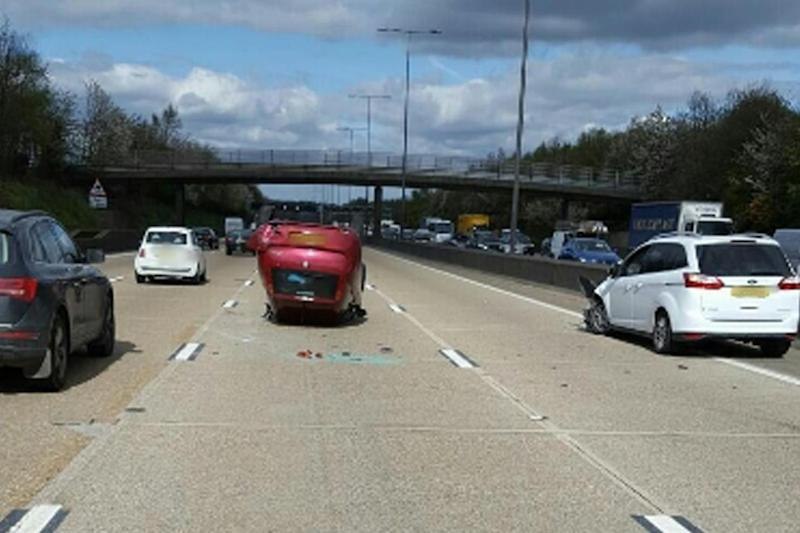 Brazen: A frustrated motorist called 999 and asked for a police escort after being caught up in the tailbacks: @SurreyRoadCops