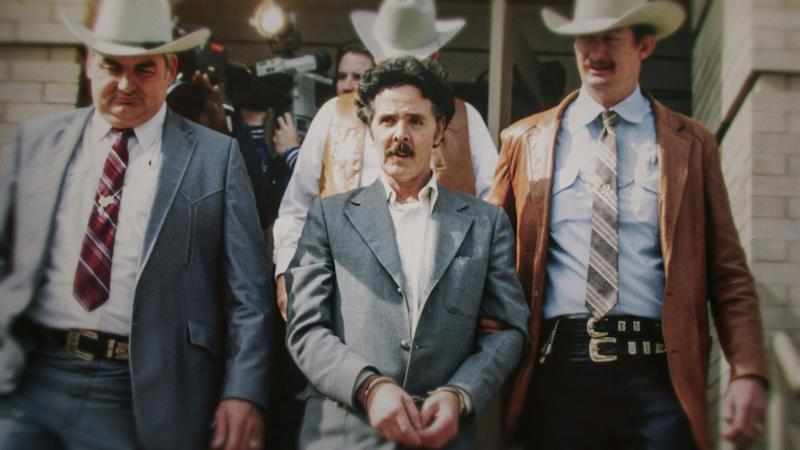 """Henry Lee Lucas (centre) being escorted by Ranger Bob Prince (left) and task force in footage from """"The Confession Killer."""" (Photo: Courtesy of Netflix)"""