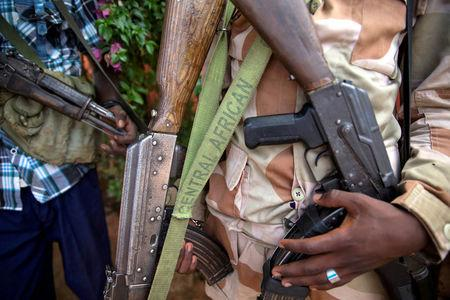 FILE PHOTO: An armed fighter belonging to the 3R armed militia displays his weapon in the town of Koui, Central African Republic