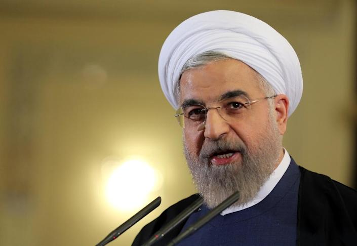 "Iranian President Hassan Rouhani says the country is about to enter ""a year of economic prosperity"" (AFP Photo/Atta Kenare)"