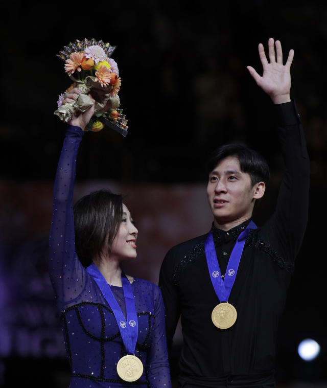 China's Sui Wenjing and Han Cong acknowledge the crowd after winning gold for the pairs free skate during the ISU World Figure Skating Championships at Saitama Super Arena in Saitama, north of Tokyo, Thursday, March 21, 2019. (AP Photo/Andy Wong)