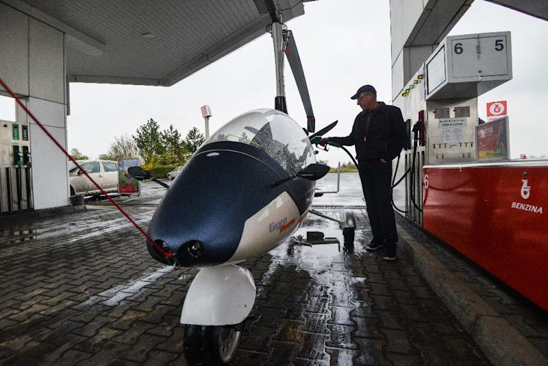 """Pavel Brezina's GyroDrive vehicle is based on a gyroplane -- a mini-helicopter -- that uses a copter-style rotor to move up and down, and an aeroplane-type """"pusher propeller"""" to go forward. (AFP Photo/Michal Cizek)"""