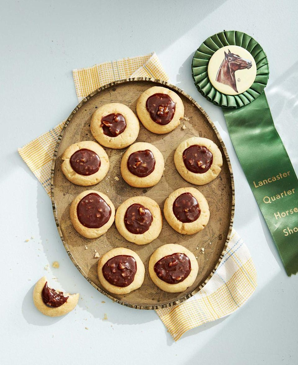 """<p>These simple cookies take less than 20 minutes to bake.</p><p><strong><a href=""""https://www.countryliving.com/food-drinks/a32042556/caramel-chocolate-walnut-thumbprint-cookies/"""" rel=""""nofollow noopener"""" target=""""_blank"""" data-ylk=""""slk:Get the recipe"""" class=""""link rapid-noclick-resp"""">Get the recipe</a>.</strong></p><p><strong><a class=""""link rapid-noclick-resp"""" href=""""https://www.amazon.com/Silpat-Perfect-Cookie-Non-Stick-Silicone/dp/B00OCIR6C6/?tag=syn-yahoo-20&ascsubtag=%5Bartid%7C10050.g.32944821%5Bsrc%7Cyahoo-us"""" rel=""""nofollow noopener"""" target=""""_blank"""" data-ylk=""""slk:SHOP NONSTICK BAKING MATS"""">SHOP NONSTICK BAKING MATS</a><br></strong></p>"""