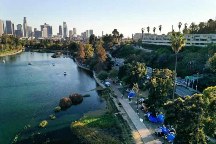LOS ANGELES, CA - MARCH 04, 2021: Echo Park has become a location where homeless people have taken up residence with tents lining the lake all along the west side. Photograph taken on March 4, 2021. (Carolyn Cole / Los Angeles Times)
