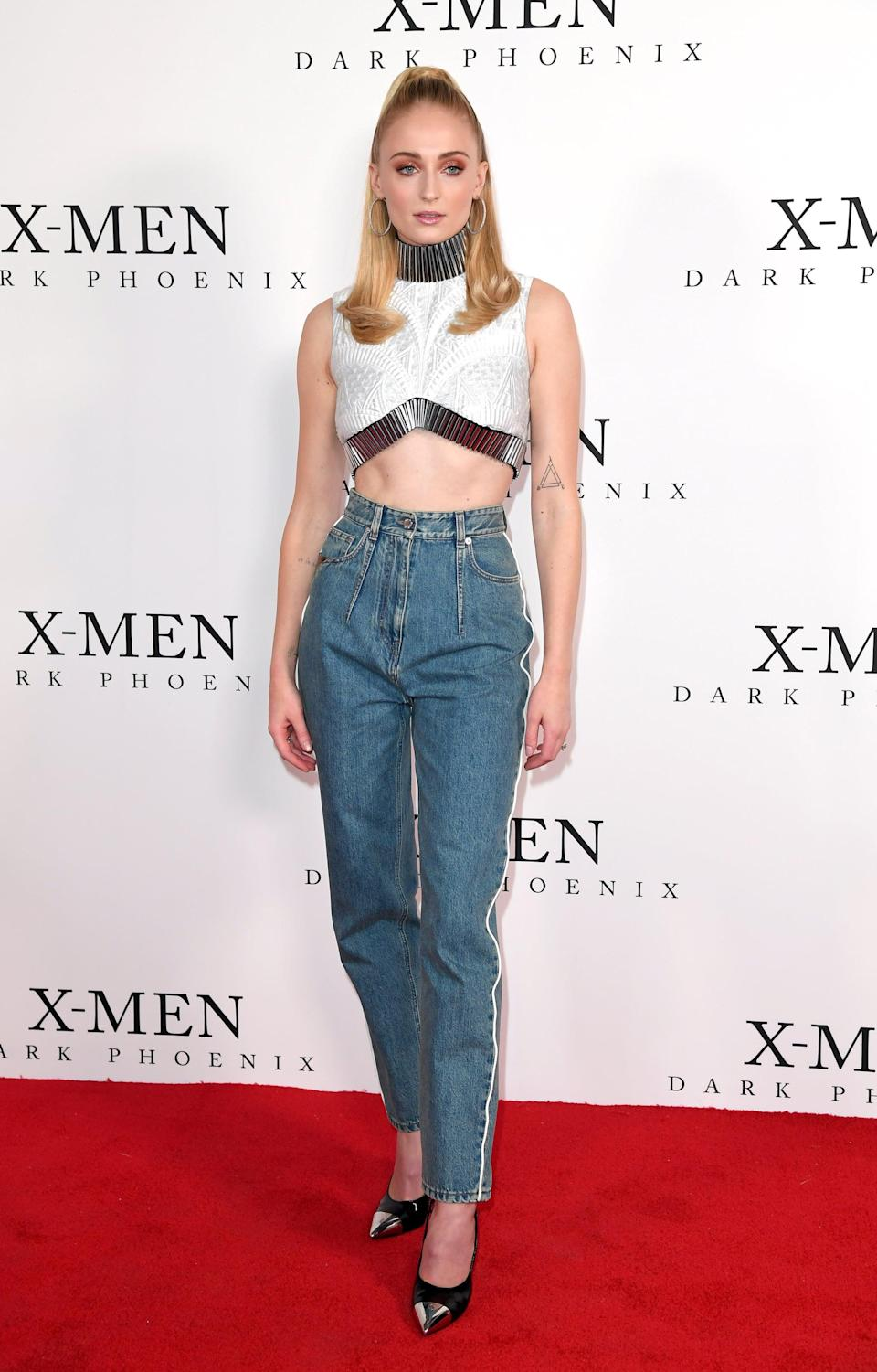 <p>Sophie channeled the '80s in these high-waist jeans with white piping and a structural crop top at a London-based <b>X-Men</b> fan event.</p>