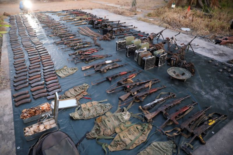 Weapons and ammunition retrieved from militants are displayed by the Rwandan security forces in Mocimboa da Praia