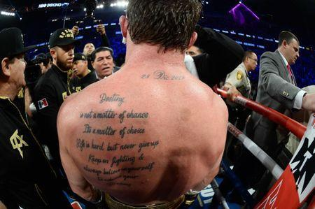 Sep 15, 2018; Las Vegas, NV, USA; A look at the tattoos of Canelo Alvarez after the middleweight world championship boxing match against Gennady Golovkin (not pictured) at T-Mobile Arena. Alvarez won via majority decision. Mandatory Credit: Joe Camporeale-USA TODAY Sports