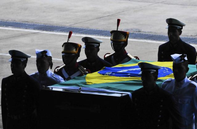 The exhumed remains of Brazil's former president Joao Goulart are carried during an arrival ceremony in Brasilia November 14, 2013. Authorities exhumed the remains of Goulart 37 years after he was laid to rest. The former head of state's remains will undergo a new autopsy amid allegations he may have been poisoned. Goulart, who was elected president in 1961, was deposed from office in 1964 by a military coup. He fled to Uruguay and then Argentina, where in 1976 he died in his sleep of an apparent heart attack. REUTERS/Andressa Anholete (BRAZIL - Tags: POLITICS)