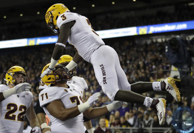 Arizona State running back Eno Benjamin (3) is tossed in the air by offensive lineman Steven Miller (71) after Benjamin scored a touchdown during the first half of an NCAA college football game against Washington, Saturday, Sept. 22, 2018, in Seattle. (AP Photo/Ted S. Warren)