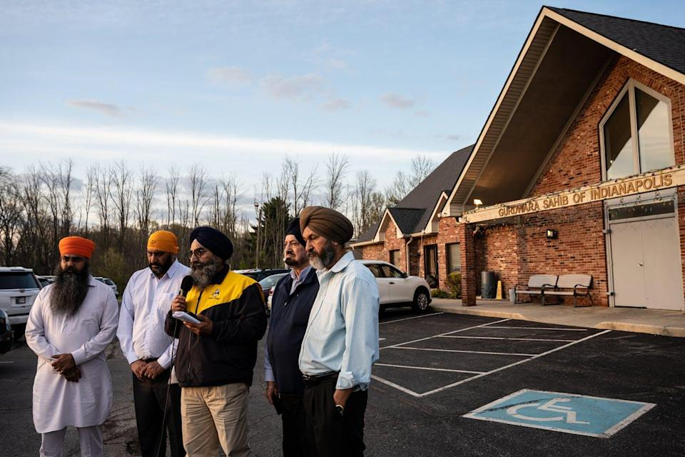 "<span class=""caption"">Members of the Sikh community in Indianapolis gather after a mass shooting in which eight people, including four Sikhs, died, in Indianapolis, Indiana.</span> <span class=""attribution""><a class=""link rapid-noclick-resp"" href=""https://www.gettyimages.com/detail/news-photo/leaders-of-the-sikh-satsang-of-indianapolis-participate-in-news-photo/1232349024?adppopup=true"" rel=""nofollow noopener"" target=""_blank"" data-ylk=""slk:Jon Cherry/Getty Images"">Jon Cherry/Getty Images</a></span>"