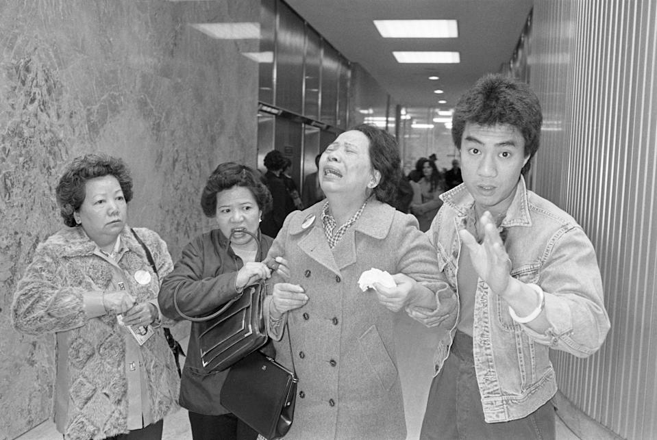 (Original Caption) Lillie Chin, mother of Vincent chin who was clubbed to death by two white men in a scuffle in June 1982, breaks down as a relative (L), helps her walk while leaving Detroit's City County Building. Mrs. Chin along with the American Citizens for Justice are asking Judge Charles Kaufman, who heard the case and passed sentence, to resentence the two involved in the slayings. Kaufman sentenced the men to 3 years probation after plea bargaining agreements. Mrs. Chin, along with the A.C.J. are asking for the maximum sentence of 15 years in prison.