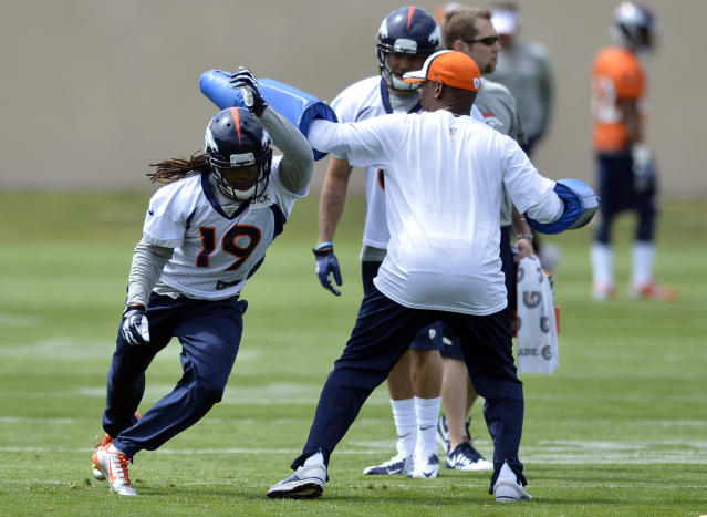 Denver Broncos' Isaiah Burse runs a drill during NFL football rookie camp, Friday, May 16, 2014, in Englewood, Colo