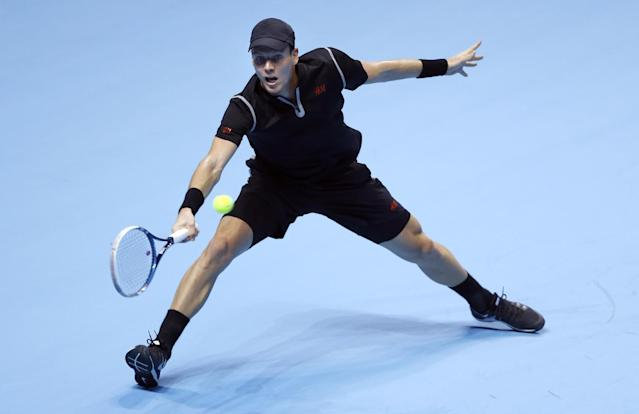 Tomas Berdych of the Czech Republic plays a return to Stanislas Wawrinka of Switzerland during their ATP World Tour Finals tennis match at the O2 Arena in London, Monday, Nov. 4, 2013. (AP Photo/Kirsty Wigglesworth)
