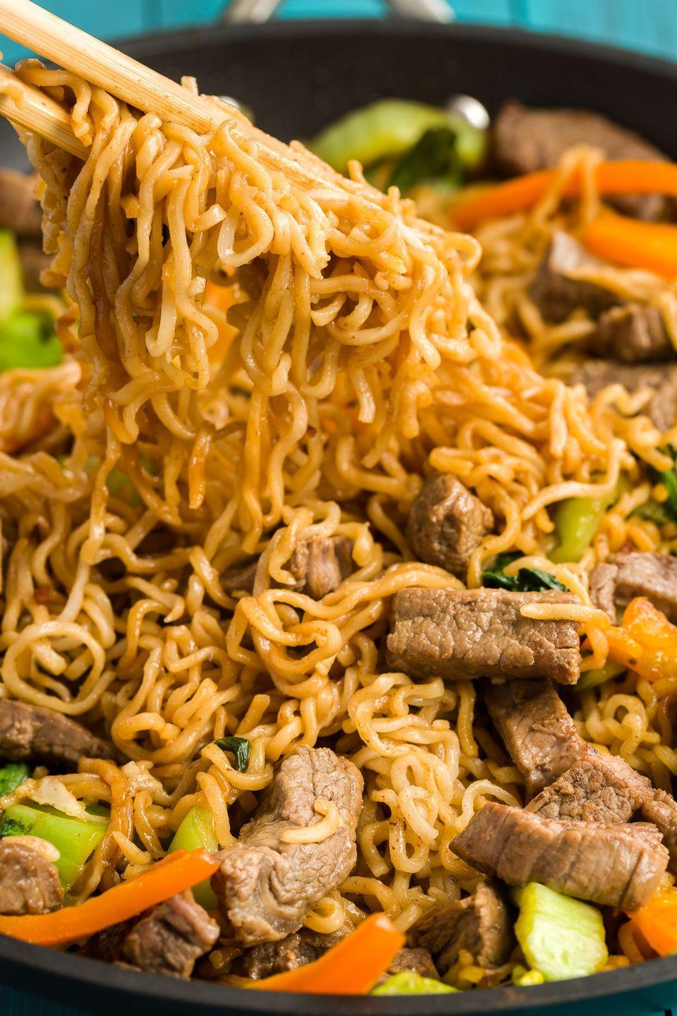 """<p>Love ramen? Start incorporating the noodles into a stir-fry with this easy weeknight dinner.</p><p>Get the recipe from <a href=""""https://www.delish.com/cooking/recipe-ideas/recipes/a46097/ramen-noodle-skillet-with-steak-recipe/"""" rel=""""nofollow noopener"""" target=""""_blank"""" data-ylk=""""slk:Delish"""" class=""""link rapid-noclick-resp"""">Delish</a>.</p>"""