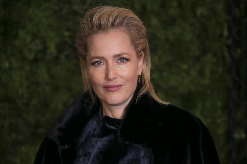Actress Gillian Anderson poses for photographers upon arrival at the World premiere of 'The Crown' season 3, in central London, Wednesday, Nov. 13, 2019. (Photo by Joel C Ryan/Invision/AP)