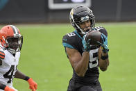 Jacksonville Jaguars wide receiver Collin Johnson (19) makes a reception in front of Cleveland Browns safety Karl Joseph during the first half of an NFL football game, Sunday, Nov. 29, 2020, in Jacksonville, Fla. (AP Photo/Phelan M. Ebenhack)