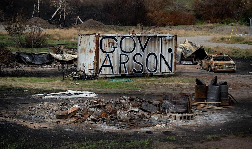 """<span class=""""caption"""">The words Government Arson are painted on a shipping container on a property that was destroyed by the White Rock Lake wildfire in August in British Columbia. </span> <span class=""""attribution""""><span class=""""source"""">THE CANADIAN PRESS/Darryl Dyck </span></span>"""