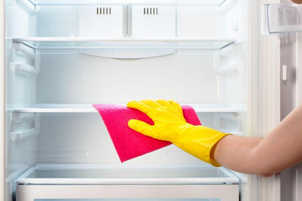 <p>Don't forget to clean behind the bins and shelves. Liquids and food particles can cause odors and mold, says Carolyn Forte, director of home appliances, cleaning products, and textiles for <em>Good Housekeeping</em>. Wipe with a microfiber cloth, then rinse and dry.</p>