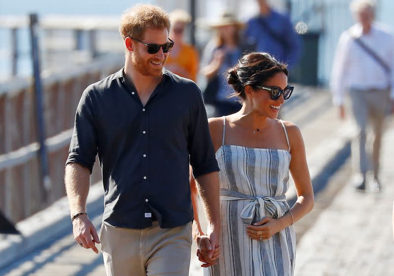 Britain's Prince Harry and Meghan, Duchess of Sussex, arrive to greet members of the public in Kingfisher Bay on Fraser Island in Queensland