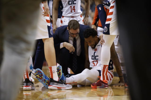 Washington Wizards guard Jordan McRae (52) sits injured on the court during the first half of the team's NBA basketball game against the Toronto Raptors on Friday, Jan. 17, 2020, in Toronto. (Cole Burston/The Canadian Press via AP)