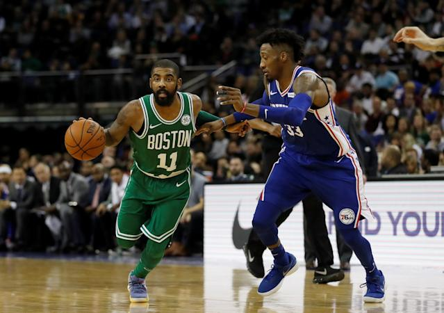 Basketball - NBA - Boston Celtics vs Philadelphia 76ers - O2 Arena, London, Britain - January 11, 2018 Boston Celtics' Kyrie Irving in action with Philadelphia 76ers' Robert Covington REUTERS/Matthew Childs