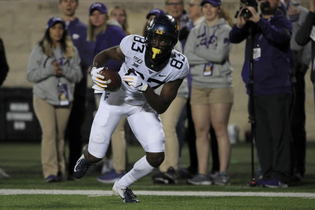 West Virginia wide receiver Bryce Wheaton (83) catches a pass and runs for a touchdown during the second half of an NCAA college football game against Kansas State in Manhattan, Kan., Saturday, Nov. 16, 2019. (AP Photo/Orlin Wagner)