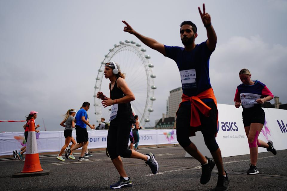 Runners on Westminster Bridge taking part in the Asics London 10k (PA) (PA Wire)