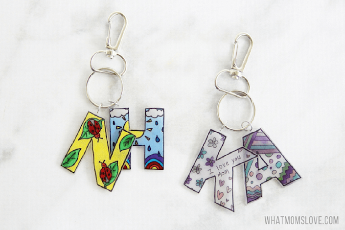 """<p>Remember Shrinky Dinks, the plastic that magically becomes miniature with the help of an oven? The same concept can be used to make a cute keychain for Mom.</p><p><strong>Get the tutorial at <a href=""""http://whatmomslove.com/kids/shrink-film-keepsake-keychain-unique-diy-gift/"""" rel=""""nofollow noopener"""" target=""""_blank"""" data-ylk=""""slk:WhatMomsLove"""" class=""""link rapid-noclick-resp"""">WhatMomsLove</a>.</strong> </p>"""