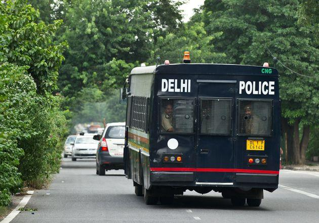 A police vehicle believed to be carrying the accused in a gangrape and murder case, leaves the Saket District Court following the verdict in New Delhi on September 10, 2013.
