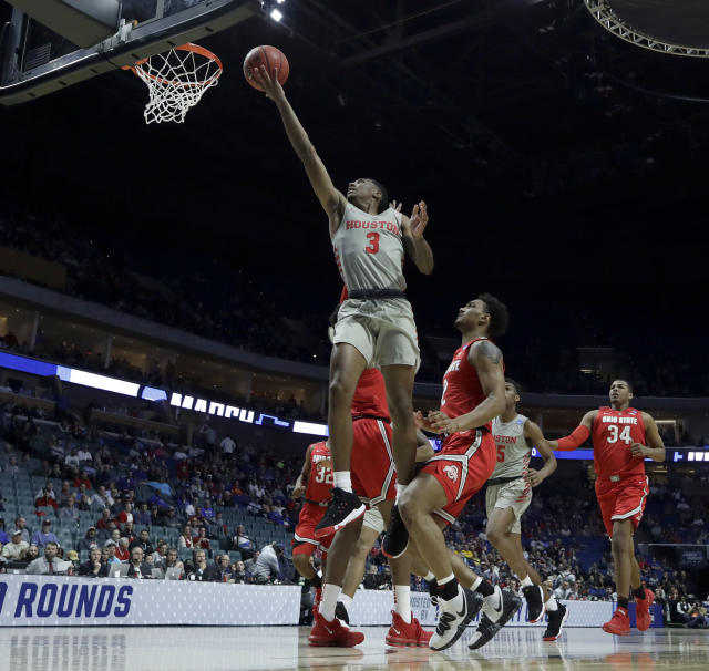 Houston's Armoni Brooks (3) puts up a shot during the first half of a second round men's college basketball game against Ohio State in the NCAA Tournament Sunday, March 24, 2019, in Tulsa, Okla. (AP Photo/Charlie Riedel)