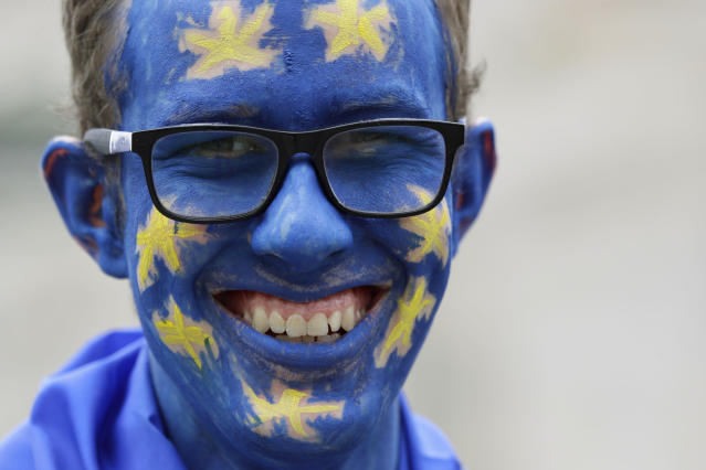 A demonstrator with his face painted in the EU colors waits for the start of a Peoples Vote anti-Brexit march in London, Saturday, March 23, 2019. The march, organized by the People's Vote campaign is calling for a final vote on any proposed Brexit deal. This week the EU has granted Britain's Prime Minister Theresa May a delay to the Brexit process. (AP Photo/Kirsty Wigglesworth)