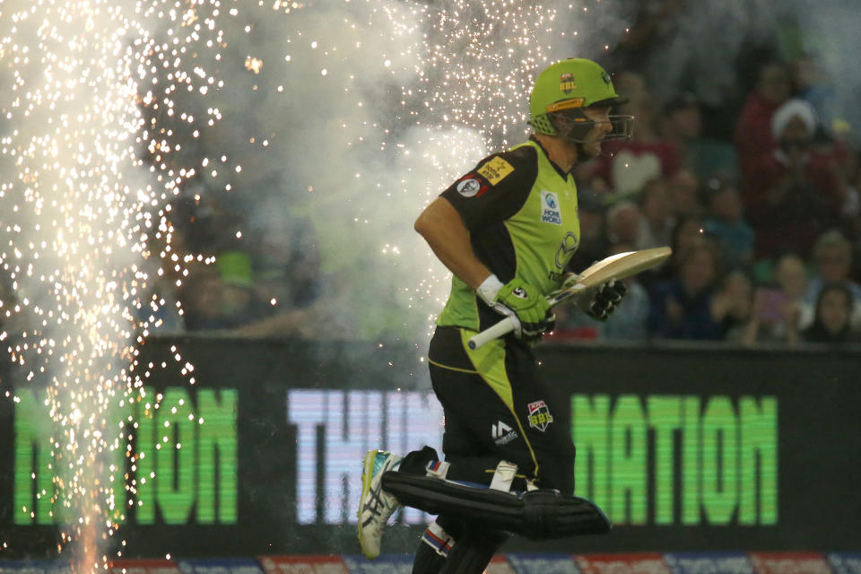 Shane Watson runs out to bat during a Big Bash League match.
