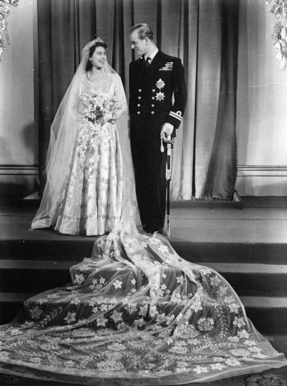 """<p>A young Princess Elizabeth with Philip Mountbatten on their <a href=""""https://www.goodhousekeeping.com/uk/news/a558113/queen-elizabeth-wedding-day-letter-from-father/"""" rel=""""nofollow noopener"""" target=""""_blank"""" data-ylk=""""slk:wedding day"""" class=""""link rapid-noclick-resp"""">wedding day</a>.</p>"""
