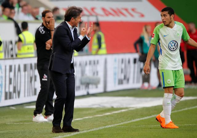 Soccer Football - Bundesliga - VfL Wolfsburg v FC Cologne - Volkswagen Arena, Wolfsburg, Germany - May 12, 2018 Wolfsburg coach Bruno Labbadia speaks with William REUTERS/Wolfgang Rattay DFL RULES TO LIMIT THE ONLINE USAGE DURING MATCH TIME TO 15 PICTURES PER GAME. IMAGE SEQUENCES TO SIMULATE VIDEO IS NOT ALLOWED AT ANY TIME. FOR FURTHER QUERIES PLEASE CONTACT DFL DIRECTLY AT + 49 69 650050
