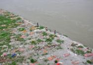 Monsoon exposes bodies buried in shallow sand graves in Phaphamau