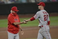Los Angeles Angels starting pitcher Andrew Heaney, right, is pulled by manager Joe Maddon during the sixth inning of the team's baseball game against the Seattle Mariners, Tuesday, Aug. 4, 2020, in Seattle. (AP Photo/Ted S. Warren)
