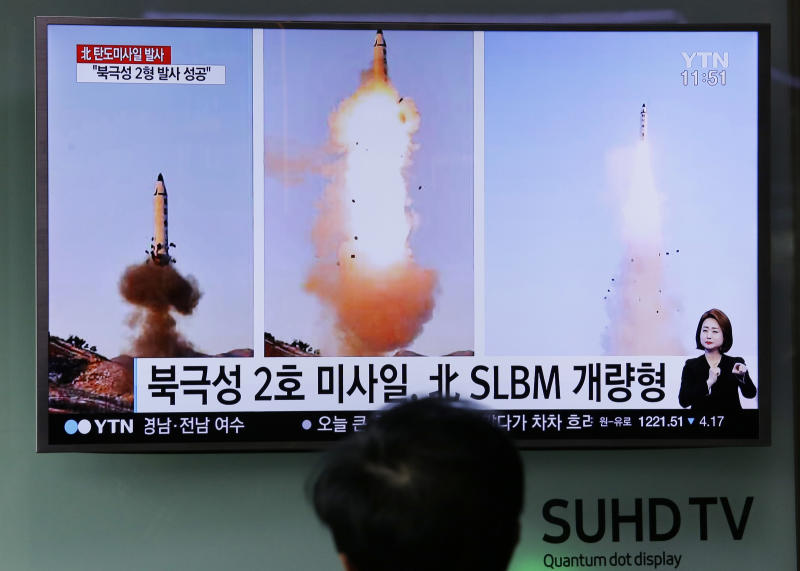 "FILE - In this Feb. 13, 2017 file photo, a man watches a TV news program showing photos published in North Korea's Rodong Sinmun newspaper of North Korea's ""Pukguksong-2"" missile launch, at Seoul Railway station in Seoul, South Korea. North Korea has vowed to bolster its defenses to protect itself against airstrikes like the ones President Donald Trump ordered against an air base in Syria. The North called the airstrikes ""absolutely unpardonable"" and said it proves that its nuclear weapons are justified to protect the country against Washington's ""evermore reckless moves for a war."" (AP Photo/Ahn Young-joon, File)"