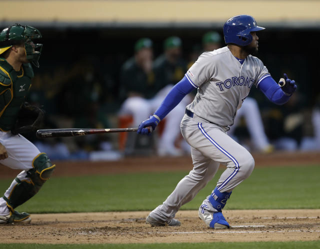 Toronto Blue Jays' Socrates Brito swings for an RBI-single off Oakland Athletics' Aaron Brooks in the second inning of a baseball game Friday, April 19, 2019, in Oakland, Calif. (AP Photo/Ben Margot)