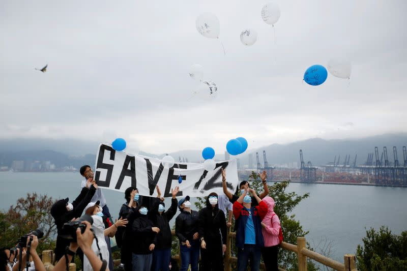 Relatives and supporters of the 12 Hong Kong people detained in mainland China release balloons in Hong Kong