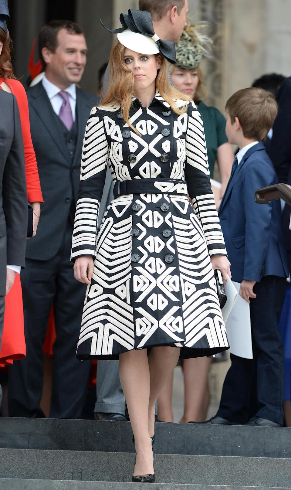 <p>Princess Beatrice is giving the Duchess of Cambridge a run for her money when it comes to chic coat dresses. For a church service for the Queen's 90th birthday, she wore this patterned Burberry number. <i>(Photo by James Whatling)</i></p>