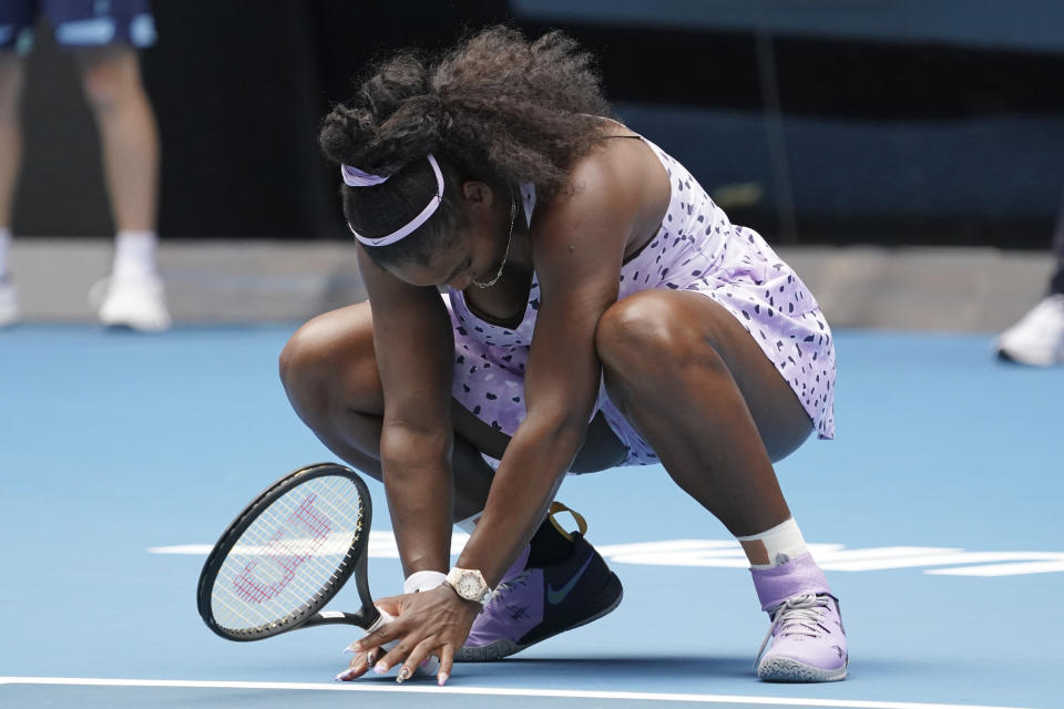 Serena Williams of the U.S. reacts as she plays against China's Wang Qiang in their third round singles match at the Australian Open tennis championship in Melbourne, Australia, Friday, Jan. 24, 2020. (AP Photo/Lee Jin-man)