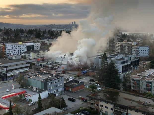 North Vancouver fire crews responded to a fire near Lonsdale Avenue and 12th Street on Tuesday morning, one of three fires at Masonic lodges in the metro Vancouver area. Police later said they had arrested a 42-year-old man in connection with the fire. (Submitted by Carol Reimer - image credit)