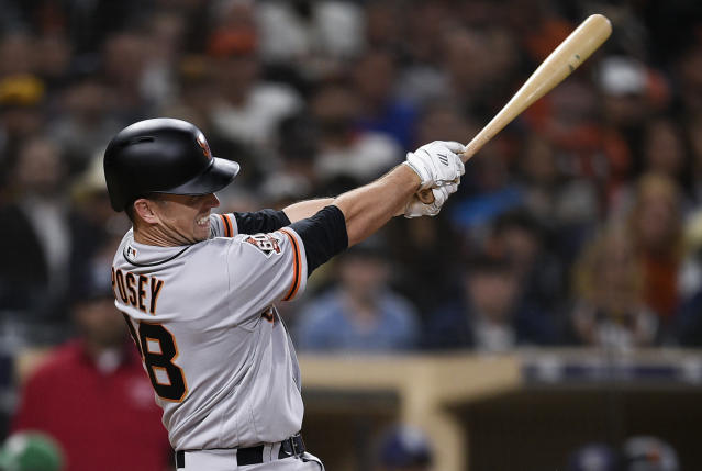 San Francisco Giants' Buster Posey follows through on a two-run double during the sixth inning of a baseball game against the San Diego Padres in San Diego, Thursday, April 12, 2018. (AP Photo/Kelvin Kuo)