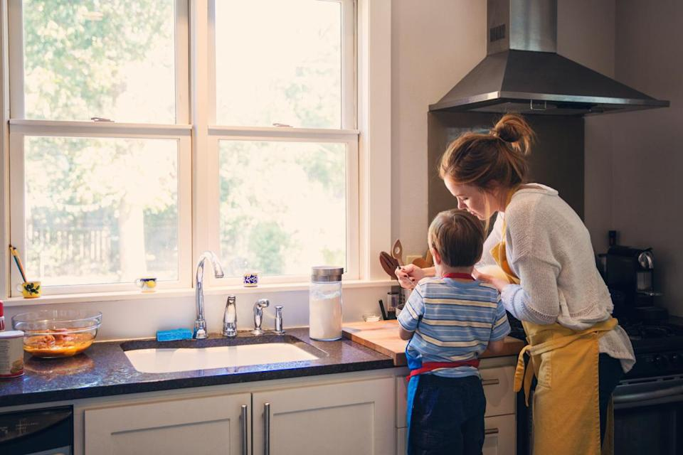 child cooking with parent