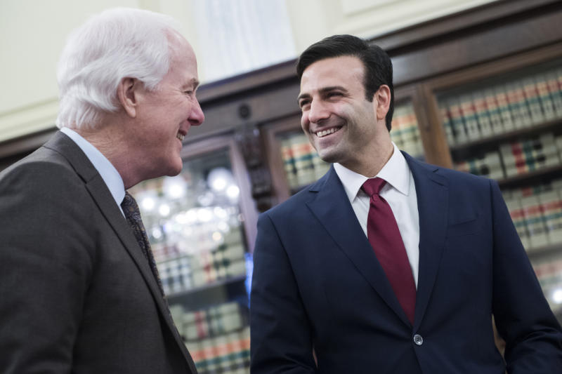Heath Tarbert, right, chairman of the Commodity Futures Trading Commission, talks with Sen. John Cornyn, R-Texas, before a Senate Agriculture, Nutrition and Forestry Committee confirmation hearing in Russell Building on Wednesday, March 13, 2019. (Tom Williams/CQ Roll Call)
