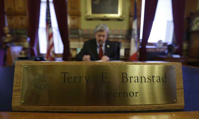 In this Dec. 19, 2012 photo, Iowa Gov. Terry Branstad works in his office at the Statehouse in Des Moines, Iowa. Iowa is one of only three states where control of the legislature is split between the parties. Instead of laying out bold initiatives for overhauling taxes or education, Branstad and legislative leaders are trying to figure out a few things they can agree on so that when the session is over, they won't wind up with nothing. (AP Photo/Charlie Neibergall)