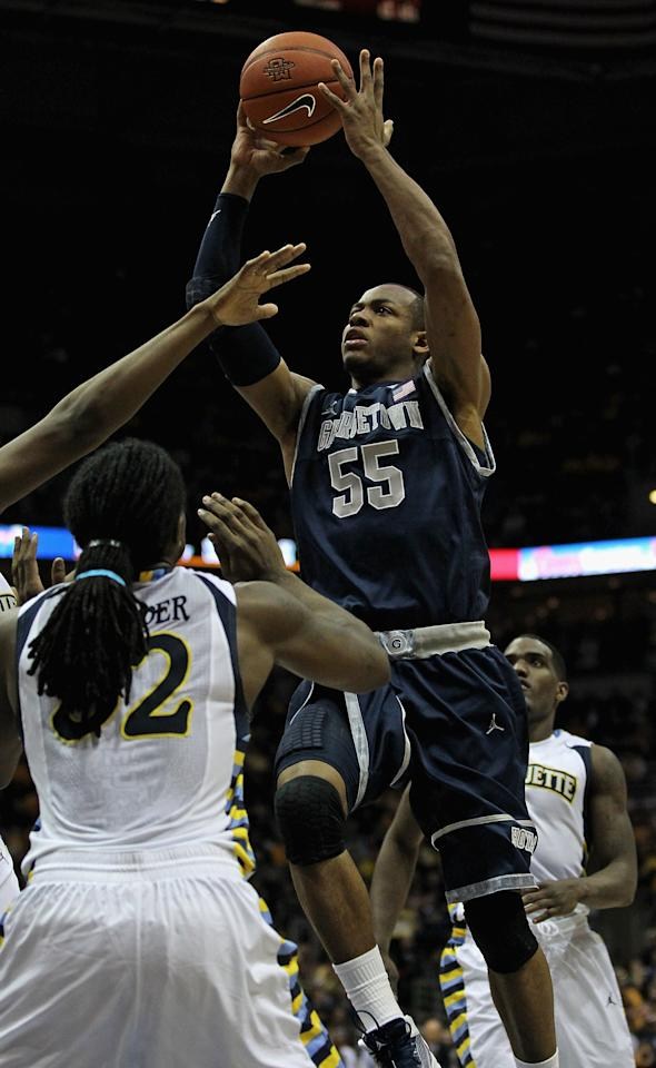 MILWAUKEE, WI - MARCH 03:  Jabril Trawick #55 of the Georgetown Hoyas shoots over Jae Crowder #32 of the Marquette Golden Eagles at the Bradley Center on March 3, 2012 in Milwaukee, Wisconsin. Marquette defeated Georgetown 83-69.  (Photo by Jonathan Daniel/Getty Images)