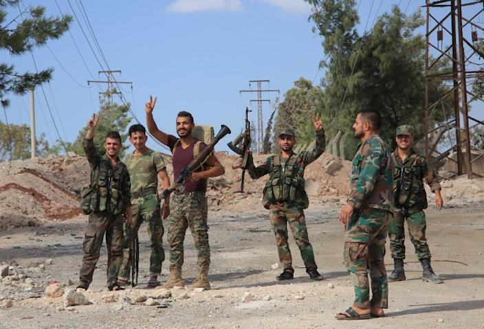 Syrian soldiers seized a military academy from rebel fighters during fierce clashes on the southern outskirts of Aleppo on Septemebr 4, 2016 (AFP Photo/George Ourfalian)