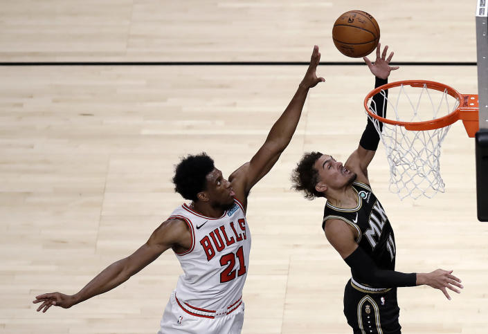 Atlanta Hawks' Trae Young, right, lays up a shot past Chicago Bulls' Thaddeus Young (21) during the first half of an NBA basketball game Friday, April 9, 2021, in Atlanta. (AP Photo/Ben Margot)